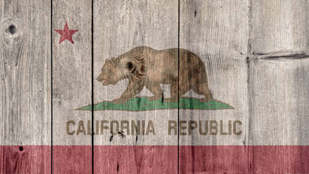 USA Politics News Concept: US State California Flag Wooden Fence
