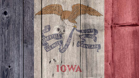 USA Politics News Concept: US State Iowa Flag Wooden Fence
