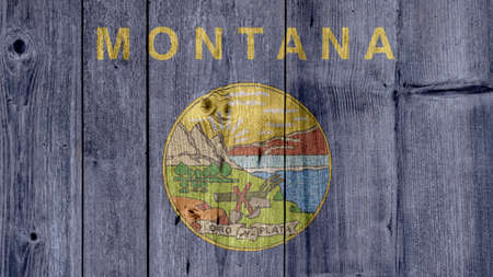 USA Politics News Concept: US State Montana Flag Wooden Fence