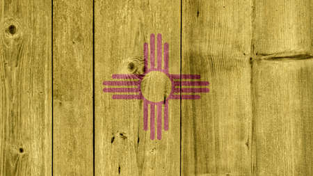 USA Politics News Concept: US State New Mexico Flag Wooden Fence