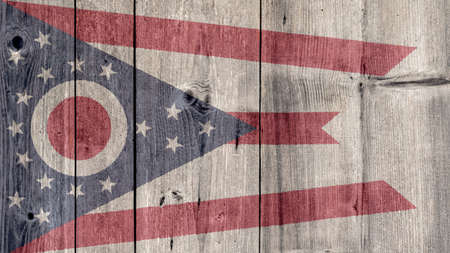 USA Politics News Concept: US State Ohio Flag Wooden Fence