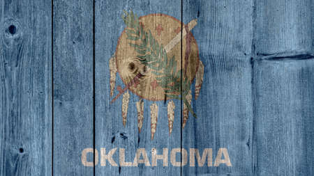 USA Politics News Concept: US State Oklahoma Flag Wooden Fence