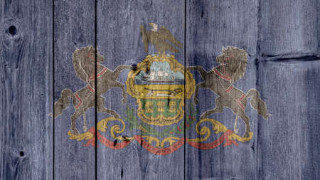 USA Politics News Concept: US State Pennsylvania Flag Wooden Fence
