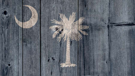 USA Politics News Concept: US State South Carolina Flag Wooden Fence