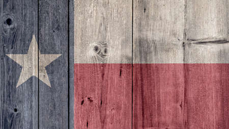 USA Politics News Concept: US State Texas Flag Wooden Fence
