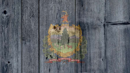 USA Politics News Concept: US State Vermont Flag Wooden Fence