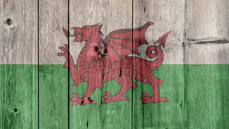 Wales Politics News Concept: Welsh Flag Wooden Fence Stock Photo