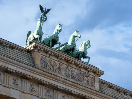 The Quadriga of Brandenburg Gate Against A Blue Cloudy Sky In Berlin, Germany