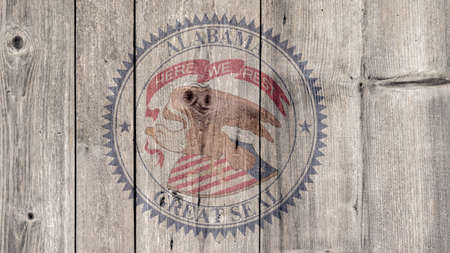 USA Politics News Concept: US State Alabama Seal Wooden Fence Background Stock Photo