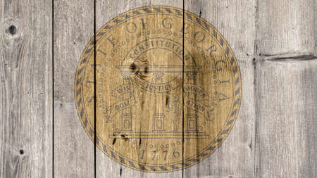 USA Politics News Concept: US State Georgia Seal Wooden Fence Background Stock Photo