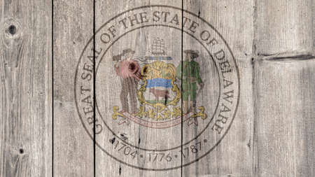 USA Politics News Concept: US State Delaware Seal Wooden Fence Background Imagens