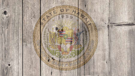 USA Politics News Concept: US State Hawaii Seal Wooden Fence Background