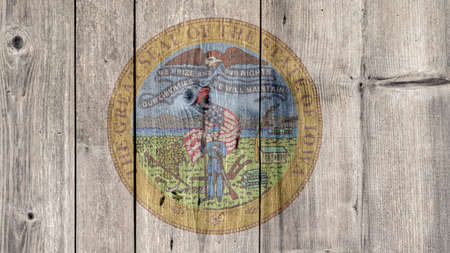 USA Politics News Concept: US State Iowa Seal Wooden Fence Background