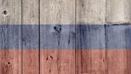 Russia Politics News Concept: Russian Flag Wooden Fence