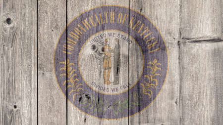 USA Politics News Concept: US State Kentucky Seal Wooden Fence Background Stock Photo