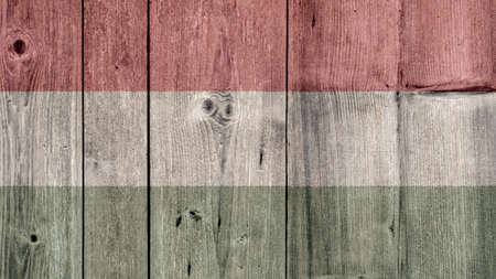 Hungary Politics News Concept: Hungarian Flag Wooden Fence