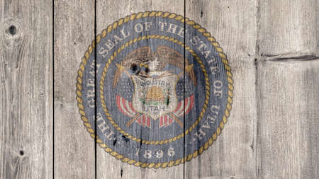 USA Politics News Concept: US State Utah Seal Wooden Fence Background