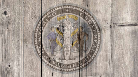 USA Politics News Concept: US State Wyoming Seal Wooden Fence Background Imagens