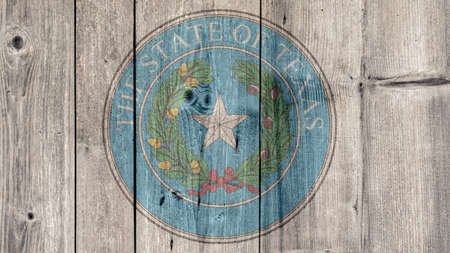 USA Politics News Concept: US State Texas Seal Wooden Fence Background