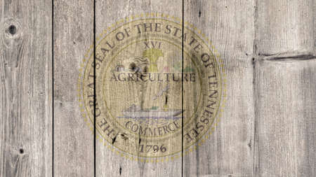 USA Politics News Concept: US State Tennessee Seal Wooden Fence Background