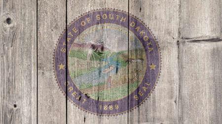 USA Politics News Concept: US State South Dakota Seal Wooden Fence Background