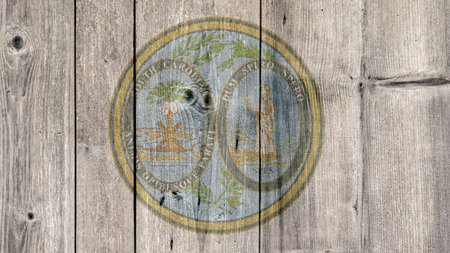 USA Politics News Concept: US State South Carolina Seal Wooden Fence Background Stock Photo