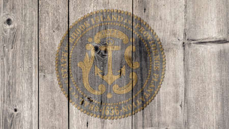 USA Politics News Concept: US State Rhode Island Seal Wooden Fence Background