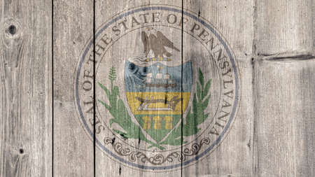 USA Politics News Concept: US State Pennsylvania Seal Wooden Fence Background