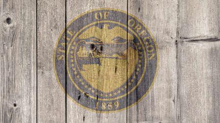 USA Politics News Concept: US State Oregon Seal Wooden Fence Background Imagens