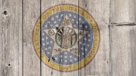 USA Politics News Concept: US State Oklahoma Seal Wooden Fence Background