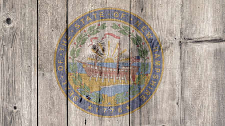 USA Politics News Concept: US State New Hampshire Seal Wooden Fence Background