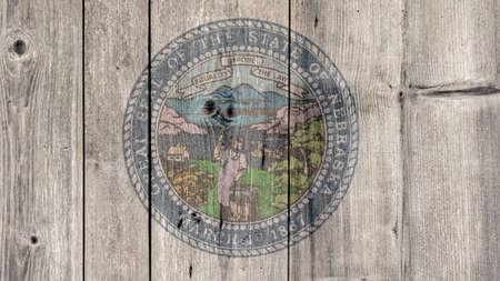 USA Politics News Concept: US State Nebraska Seal Wooden Fence Background