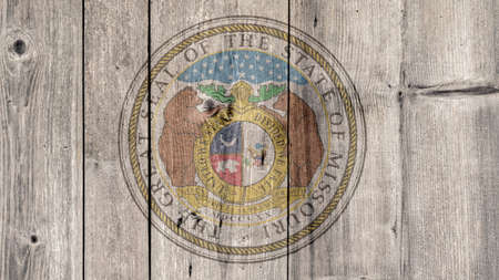 USA Politics News Concept: US State Missouri Seal Wooden Fence Background