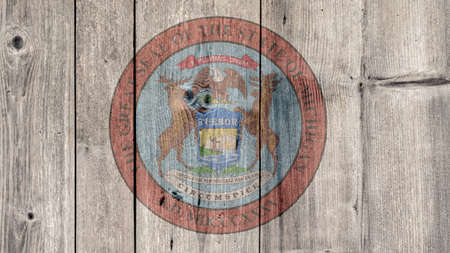 USA Politics News Concept: US State Michigan Seal Wooden Fence Background