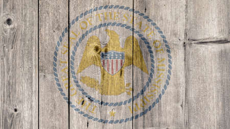 USA Politics News Concept: US State Mississippi Seal Wooden Fence Background