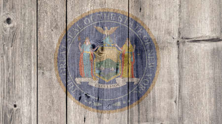 USA Politics News Concept: US State New York Seal Wooden Fence Background