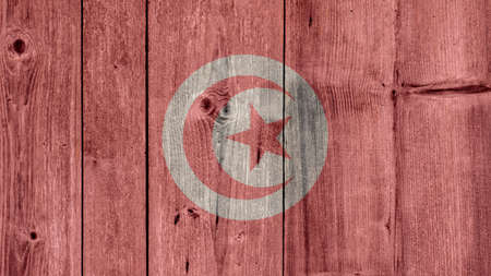 Tunisia Politics News Concept: Tunisian Flag Wooden Fence