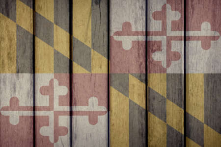 USA Politics News Concept: US State Maryland Flag Wooden Fence