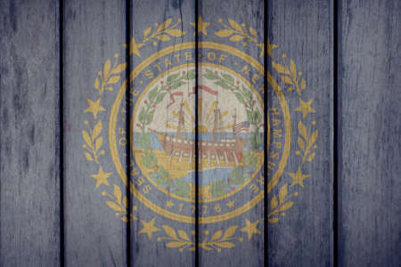 USA Politics News Concept: US State New Hampshire Flag Wooden Fence Stock Photo