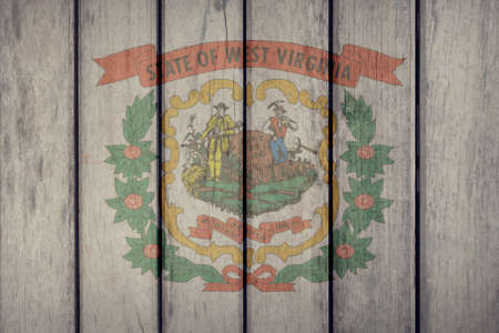 USA Politics News Concept: US State West Virginia Flag Wooden Fence