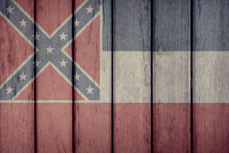 USA Politics News Concept: US State Mississippi Flag Wooden Fence Stock Photo