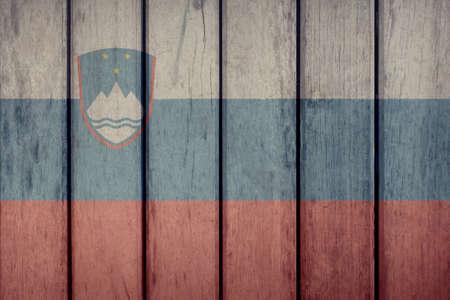 Slovenia Politics News Concept: Slovenian Flag Wooden Fence