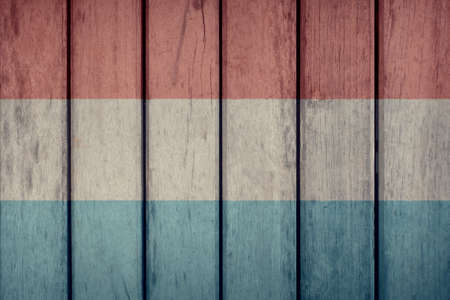 Luxembourg Politics News Concept: Luxembourgish Flag Wooden Fence