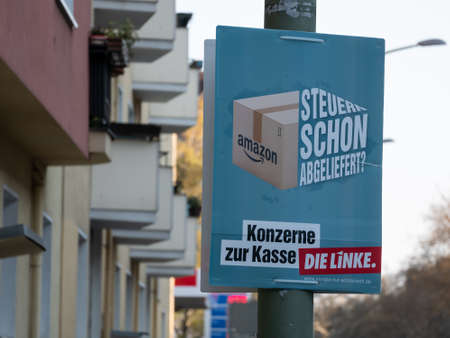 BERLIN, GERMANY - APRIL 16, 2019: Amazon Taxes Poster of The Left For The Elections To The European Parliament In Berlin, Germany Redactioneel