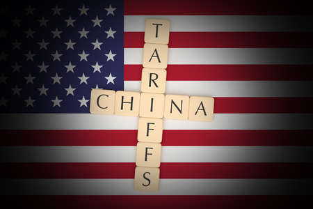 BERLIN, GERMANY - MAY 12, 2019: Letter Tiles Tariffs And China With US Flag, 3d illustration