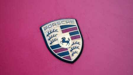 BERLIN, GERMANY - JUNE 1, 2019: The Logo of Porsche On A Purple Car