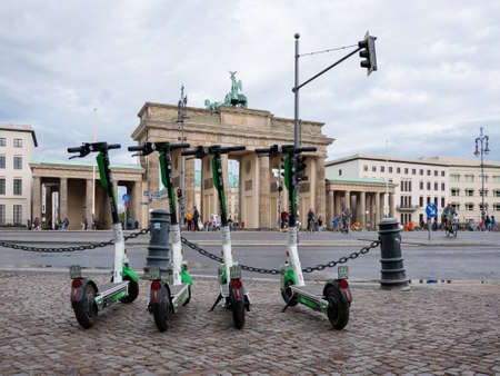 BERLIN, GERMANY - JULY 8, 2019: Motorized Electric Scooters At Brandenburg Gate In Berlin, Germany In Summer