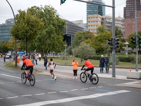 BERLIN, GERMANY - SEPTEMBER 29, 2019: Winner Kenenisa Bekele At Berlin Marathon 2019 With Skyscrapers of Potsdamer Platz In Berlin, Germany