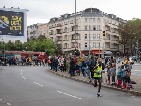 BERLIN, GERMANY - SEPTEMBER 29, 2019: Kennedy Naibei At Berlin Marathon 2019 With Adidas Advertisement In The Background In Berlin, Germany
