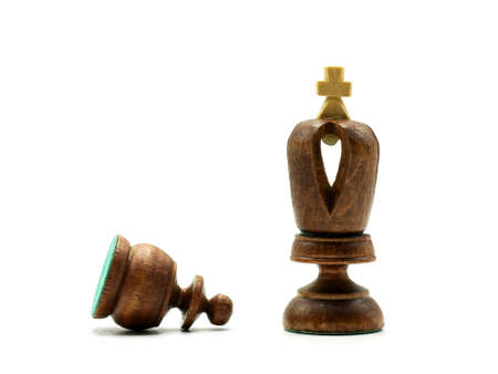 Obedience Chess Concept: Pawn Lying In Front of A King Chess Piece, Isolated On White Background